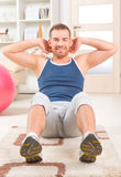 Handsome man doing sit ups Stock Image
