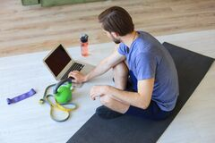 Free Handsome Man Doing Sport Exercise At Home During Quarantine. Concept Of Healthy Life Stock Photo - 183032870
