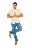 Handsome man doing the tree pose Stock Photo