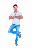 Handsome man doing the tree pose Royalty Free Stock Image