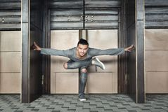 Handsome man doing yoga on urban background stock photography