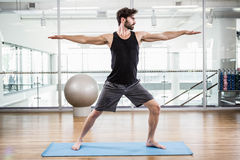 Handsome man doing yoga on mat Royalty Free Stock Photos
