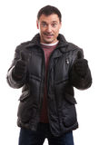 Handsome man in a down jacket showing his thumbs up Royalty Free Stock Photos
