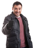 Handsome man in a down jacket showing his thumbs up Royalty Free Stock Photo