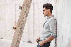 Handsome man dressed in a blue jeans shirt royalty free stock photo