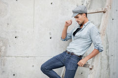 Handsome man dressed in a blue jeans shirt Stock Image