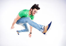 Handsome man dressed casual jumping and smiling  - dynamic wide shot Royalty Free Stock Image