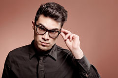 Handsome man dressed casual wearing glasses Stock Image