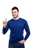 Handsome man pointing or pushing a button Royalty Free Stock Photos