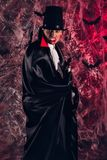 Handsome man dressed in a Dracula costume for Halloween. Royalty Free Stock Images