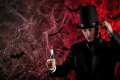 Handsome man dressed in a Dracula costume for Halloween. Royalty Free Stock Photography