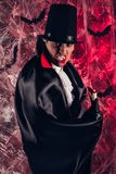 Handsome man dressed in a Dracula costume for Halloween. Stock Images