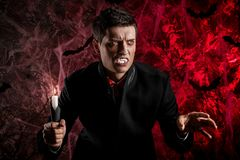 Handsome man dressed in a Dracula costume for Halloween. Stock Photo