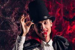 Handsome man dressed in a Dracula costume for Halloween. Stock Image