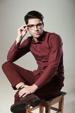 Handsome man dressed elegant posing in the studio Royalty Free Stock Image