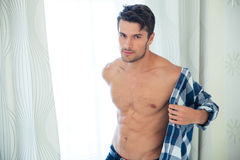 Handsome man dressing shirt stock photos
