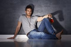 Handsome man drinking alone Stock Images
