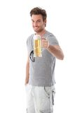 Handsome man drinking beer smiling Royalty Free Stock Photography
