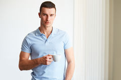 Handsome man drinking coffee Stock Images