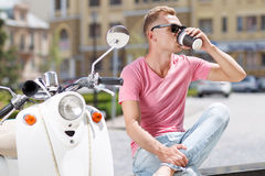 Handsome man drinking coffee in park Stock Photos