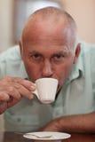 Handsome man drinking an espresso Stock Photos