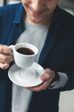 Handsome man is drinking hot beverage Royalty Free Stock Photo