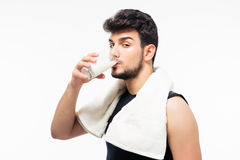 Handsome man drinking milk. Isolated on a white background. Looking at camera Stock Image