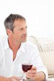 Handsome man drinking some red wine Royalty Free Stock Photography