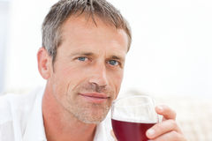 Handsome man drinking some red wine Stock Image