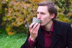 Handsome man drinking tea outdoors royalty free stock photos