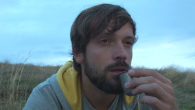 Handsome man drinking tea outdoors stock video