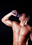 Handsome man drinking water Stock Photo
