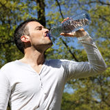 Handsome man drinking water Stock Photography