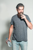 Handsome man drinks water Stock Images