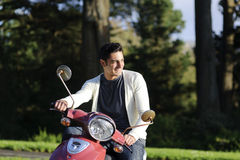 Handsome man drive scooter Royalty Free Stock Photos