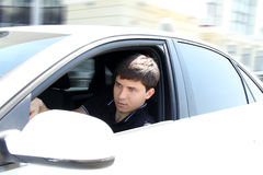Handsome man Driving a car at city Stock Photography
