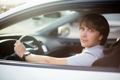 Handsome man driving his car. Looking at camera Royalty Free Stock Photo