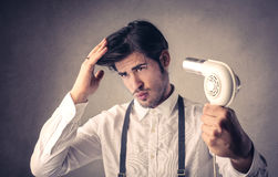 Handsome man drying his hair stock image