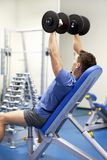 Handsome man with dumbbells Stock Image
