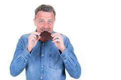 Free Handsome Man Eating Bitting A Chocolate Bar Aside Copy Space White Background Royalty Free Stock Image - 179526646