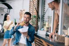 handsome man eating burger stock image