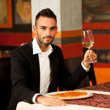 Handsome Man eating pizza in restaurant Stock Image