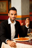 Handsome Man eating pizza in restaurant Royalty Free Stock Photography