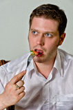 Handsome man eating salad. Stock Images