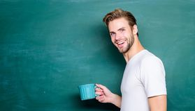 Handsome man enjoy hot coffee. Coffee addicted. Inspiring drink. Dose of caffeine. Teacher drink coffee chalkboard