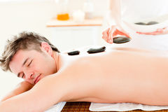 Handsome man enjoying a back massage Royalty Free Stock Photography