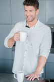 Handsome man enjoying a mug of fresh coffee Stock Photography