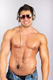 Handsome man enjoying music on headphones Stock Photography