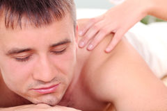 Handsome man enjoying procedure of massage Stock Photo