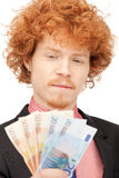 Handsome man with euro cash money Royalty Free Stock Photography